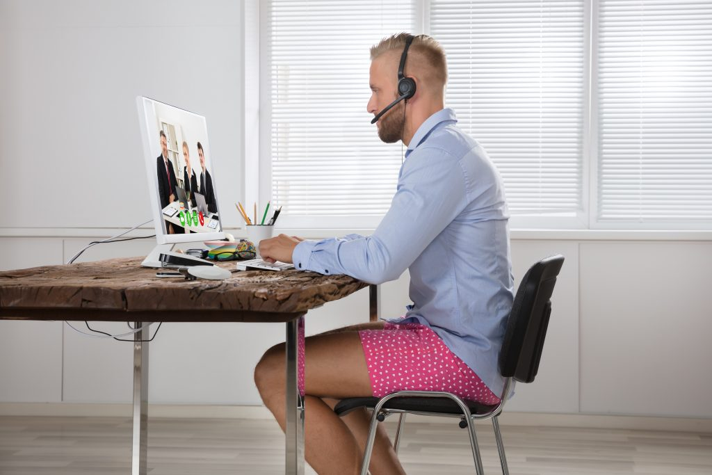 Businessman,Dressed,In,Shirt,And,Shorts,Having,Video,Call,On