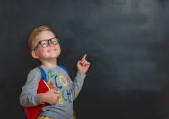 Back,To,School.,Funny,Little,Boy,In,Glasses,Pointing,Up