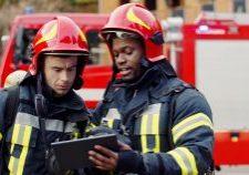 Portrait,Of,Two,Firefighters,In,Fire,Fighting,Operation,,Fireman,In